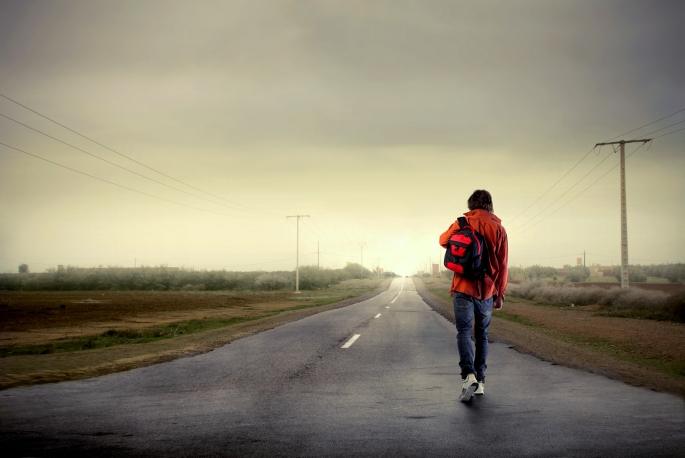 bigstock-Young-man-walking-on-a-country-13798088