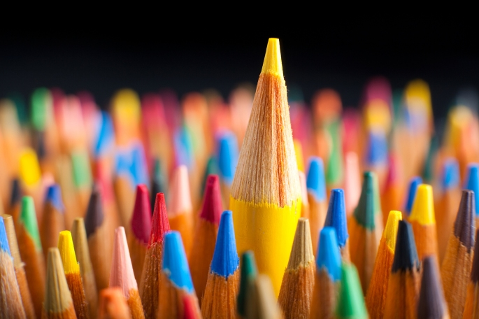 Color pencils representing the concept of Standing out from the crowd